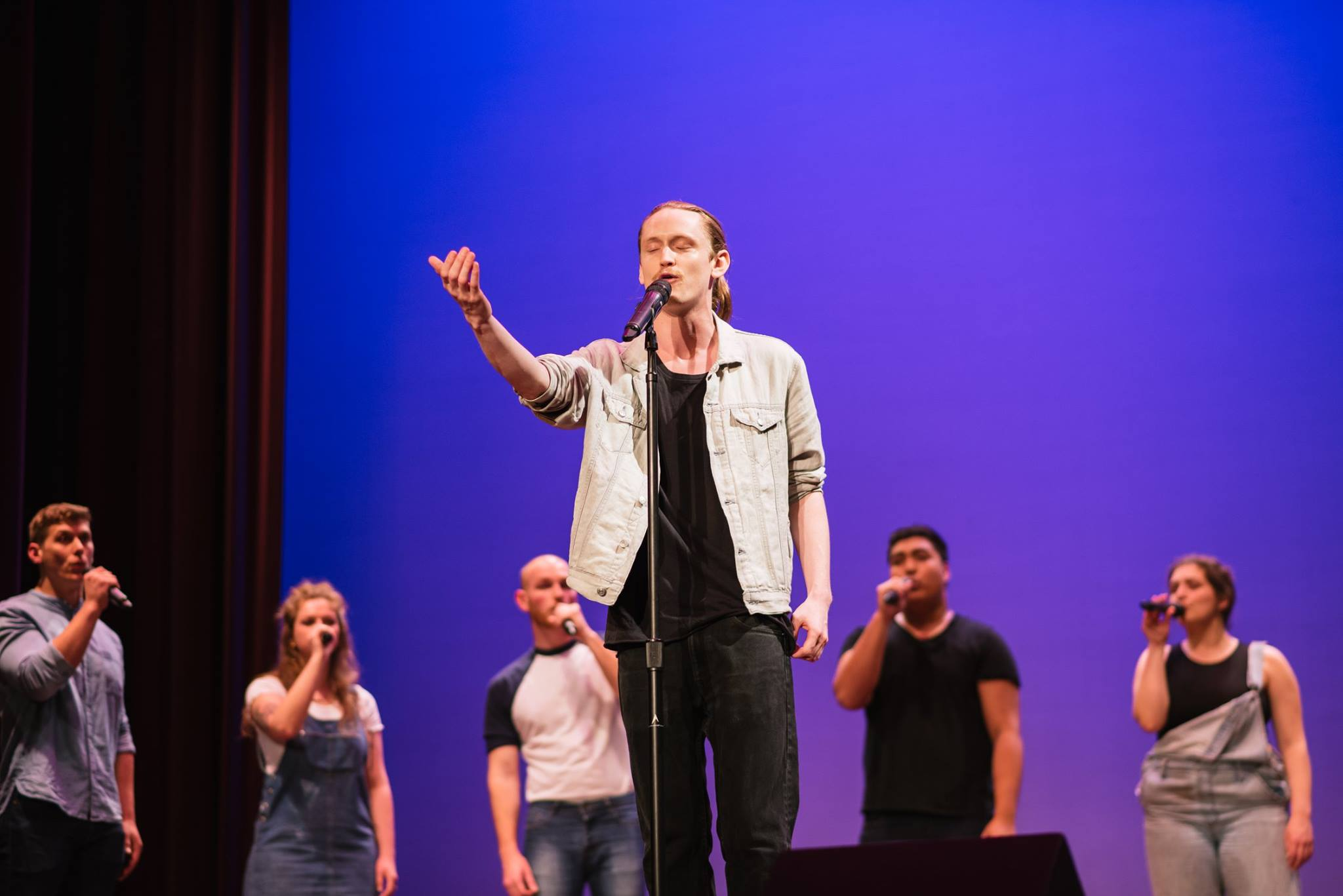 "Pirtle performing his slam poem ""Run East"" with the 'Club"